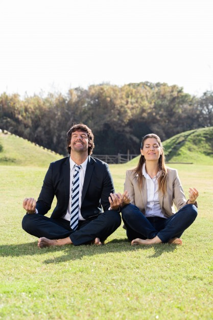 cheerful-businesspeople-in-the-lotus-position_23-2147562314